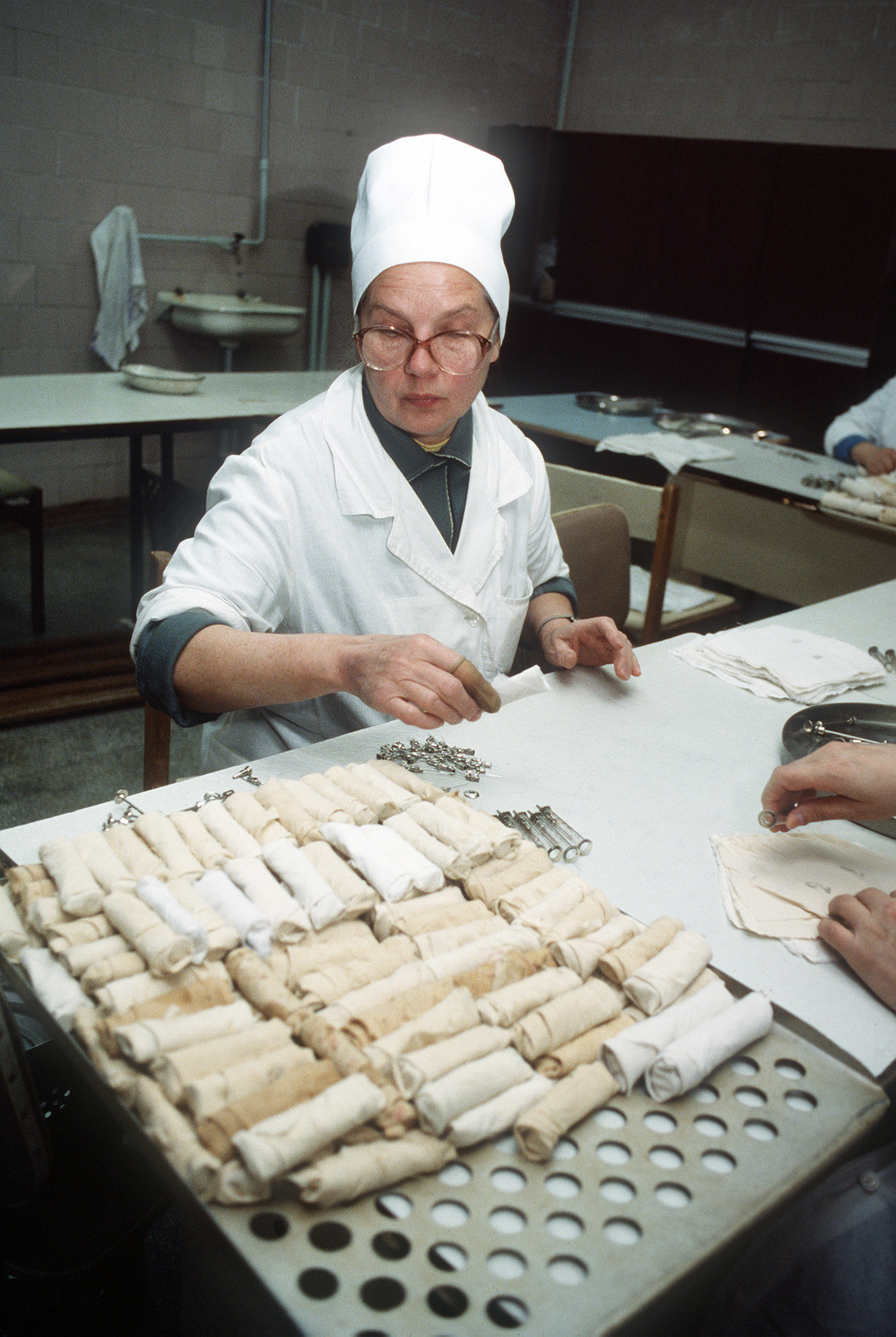 A nurse prepares needles and syringes for sterilization at a hospital in Bishkek. The syringes and needles are reused due to the shortage of medical supplies. To alleviate such shortages, the U.S. Army's 7th Medical Command is coordinating delivery of materials and equipment as part of Operation Provide Hope III