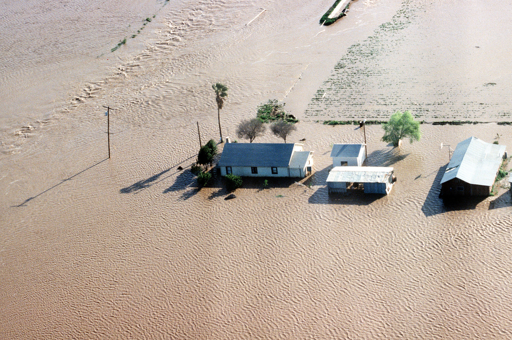 An aerial view of a flooded farm near Yuma after flood waters broke through the Painted Rock Dam. The U.S. Army Corps of Engineers is in the area to construct barriers in an effort to protect surrounding communities from the waters of the flooded Gila River