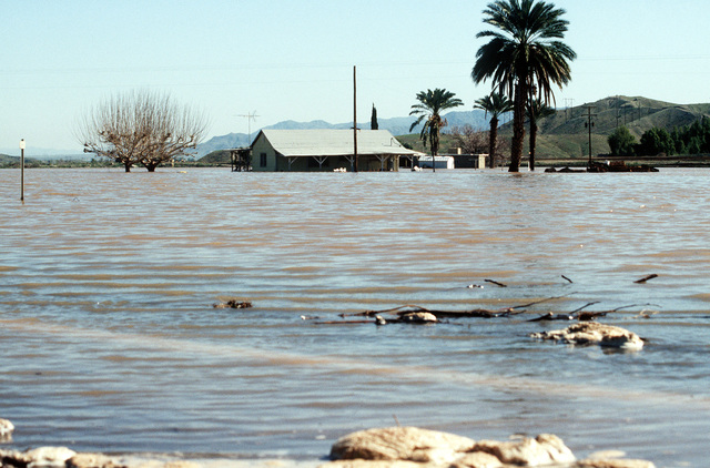 Flood waters cover Highway 95 and surrounding farmland after breaking through the Painted Rock Dam. The U.S. Army Corps of Engineers is in the area to construct barriers in an effort to protect surrounding communities from the waters of the flooded Gila River