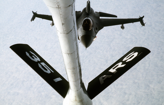 A view from the boom operator's window of a KC-135 Stratotanker aircraft as an F-16C Fighting Falcon aircraft from Ramstein Air Base, Germany, approaches the refueling boom. The KC-135 is assigned to the 351st Air Refueling squadron, 100th Air Refueling Wing