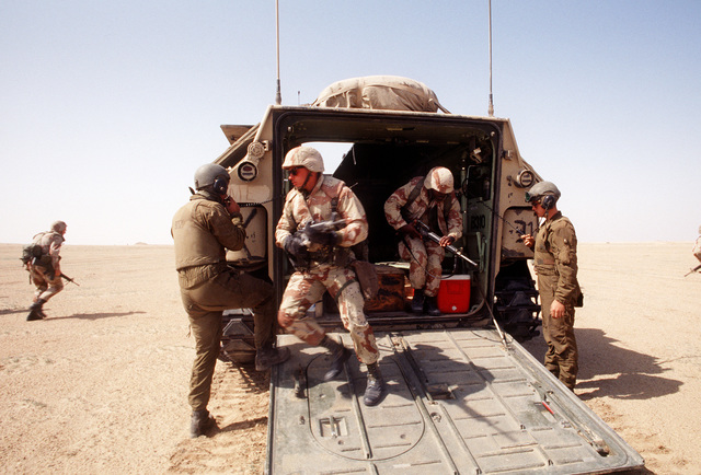 Members of the 22nd Marine Expeditionary Unit (Special Operations Capable) charge out of an AAVP-7A1, the first major U.S./Kuwaiti combined service exercise since the end of Operation Desert Storm