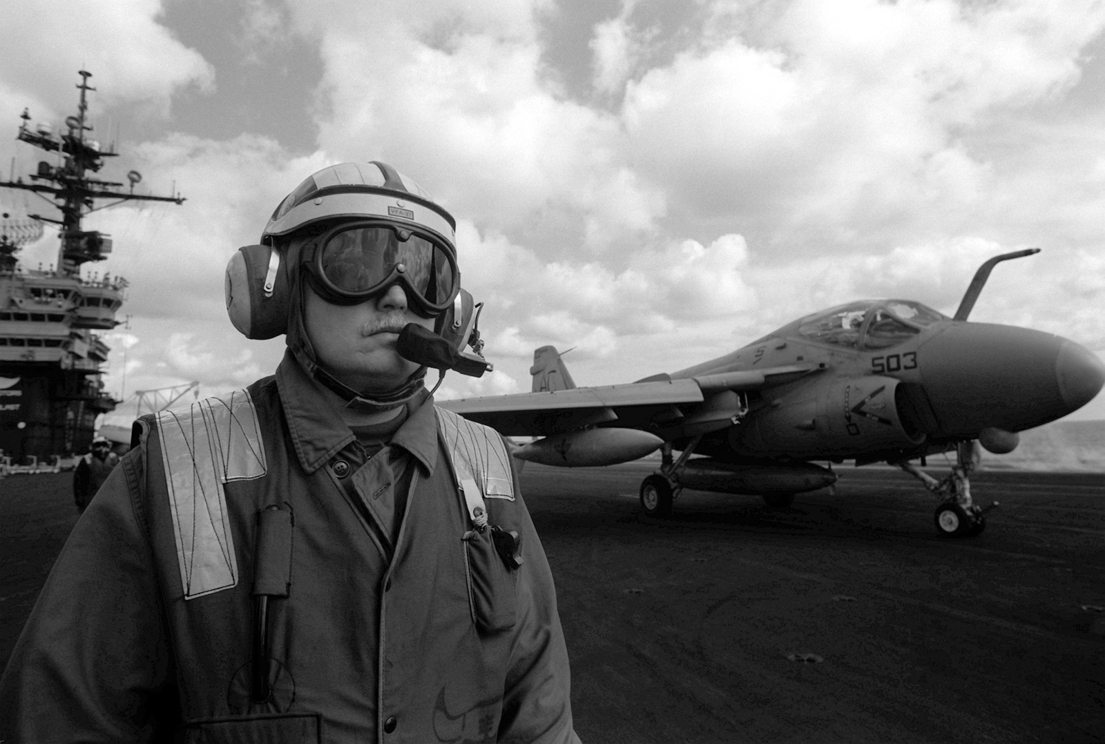A flight deck member stands by as an Attack Squadron 75 (VA-75) A-6E Intruder aircraft is readied for launch during flight operations aboard the aircraft carrier USS JOHN F. KENNEDY (CV-67)