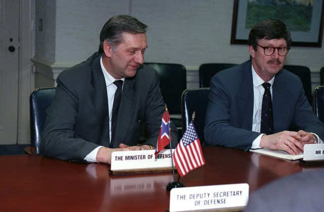 Mr. Johan Jorgen Holst (left), Norwegian Foreign Minister, sits in a meeting at the Pentagon, Washington, D.C., March 16, 1993.  OSD Package No. A07D-00152 (DOD PHOTO by Helene C. Stikkel) (Released)