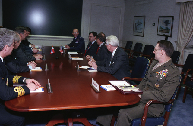The Honorable William J. Perry (right center), U.S. Deputy Secretary of Defense, attends a meeting with Johan Jorgen Holst (left center), Norwegian Foreign Minister, at the Pentagon, Washington, D.C., March 16, 1993.  OSD Package No. A07D-00152 (DOD PHOTO by Helene C. Stikkel) (Released)