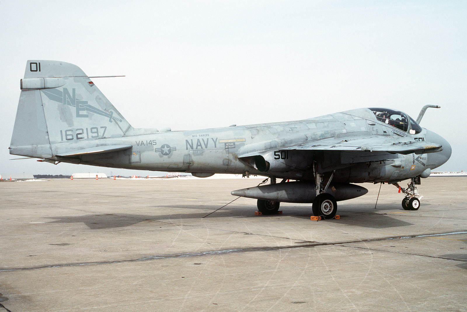 A right side view of an Attack Squadron 145 (VA-145) A-6E Intruder aircraft parked on the flight line