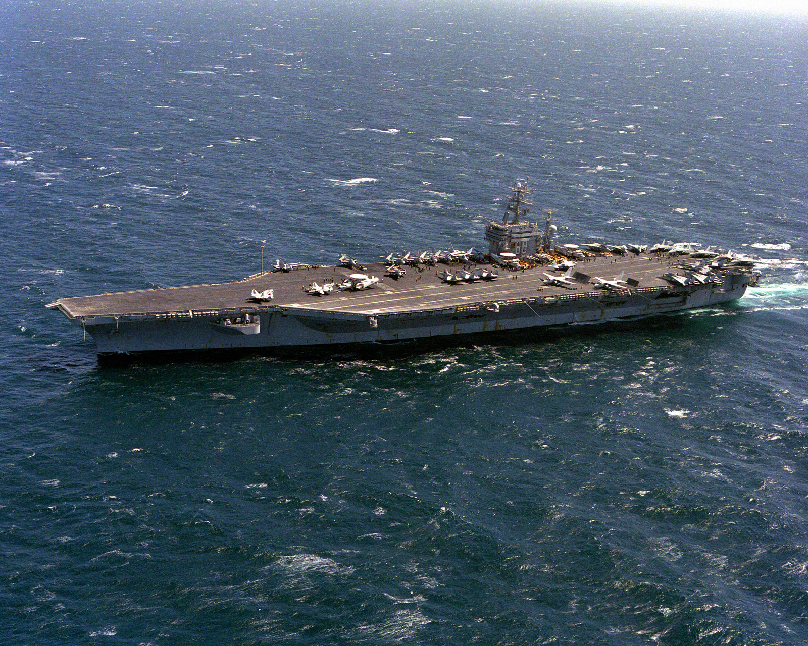 A port bow view of the nuclear-powered aircraft carrier USS