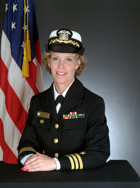 CMDR. Judith A. Holden, USN (covered)