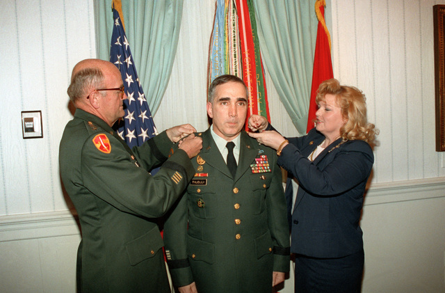 General Gorden R. Sullivan, CHIEF of STAFF, US Army, promotes Assistant Deputy CHIEF of STAFF for Operations and Plans, Major General John H. Tilelli to Lieutenant General. Lieutenant General Tilelli's wife, Valerie, completes the ceremony