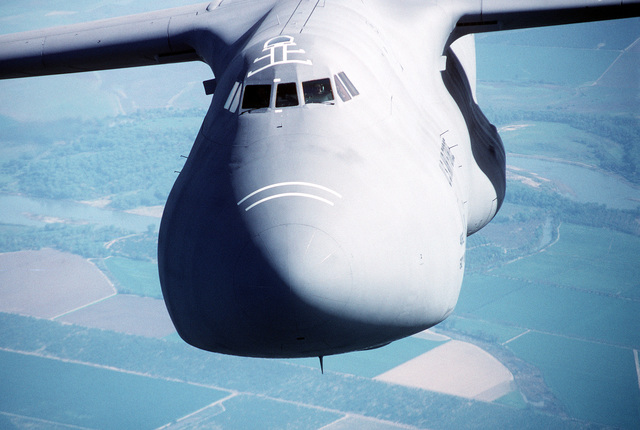 Air-to-air, close-up, front view of a 60th Airlift Wing C-5B Galaxy airlifter, flying over the farmland of northern California. Exact Date Shot Unknown