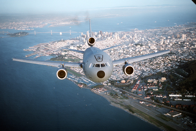 Air-to-air, front view of a 22nd Air Refueling Wing KC-10A Extender from March AFB, California flying over the city of San Francisco with the Bay Bridge in the background. Exact Date Shot Unknown