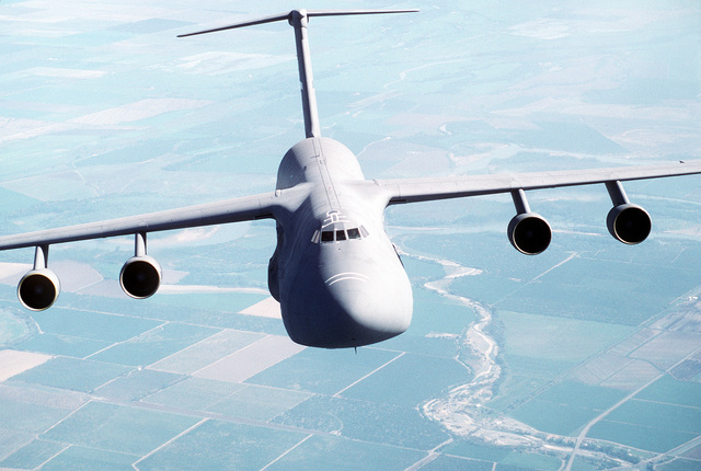Air-to-air, front view of a 60th Airlift Wing C-5B Galaxy airlifter, flying over the farmland of northern California. Exact Date Shot Unknown