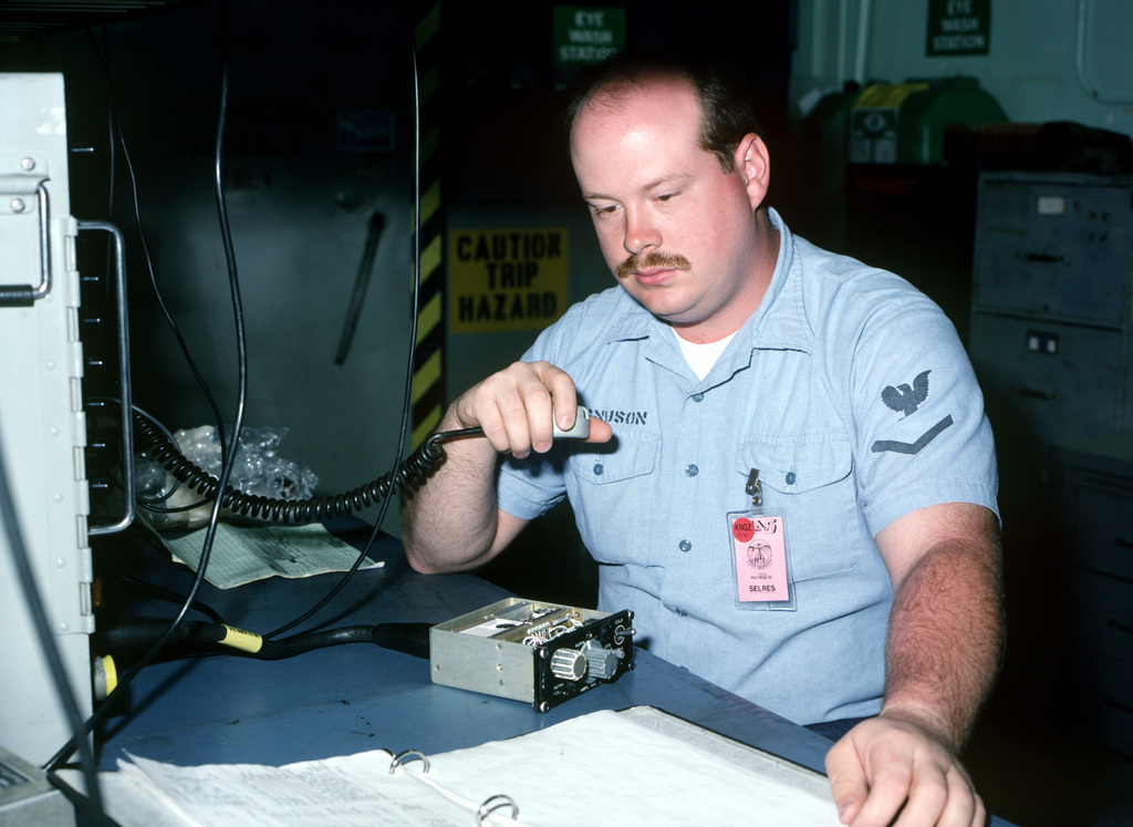 Aviation Electronics Technician 3rd Class Magnuson, assigned to the Naval Air Reserve Center in Minneapolis, Minn., troubleshoots an aircraft intercom system. Magnuson is at the air station for a two-week active duty training period