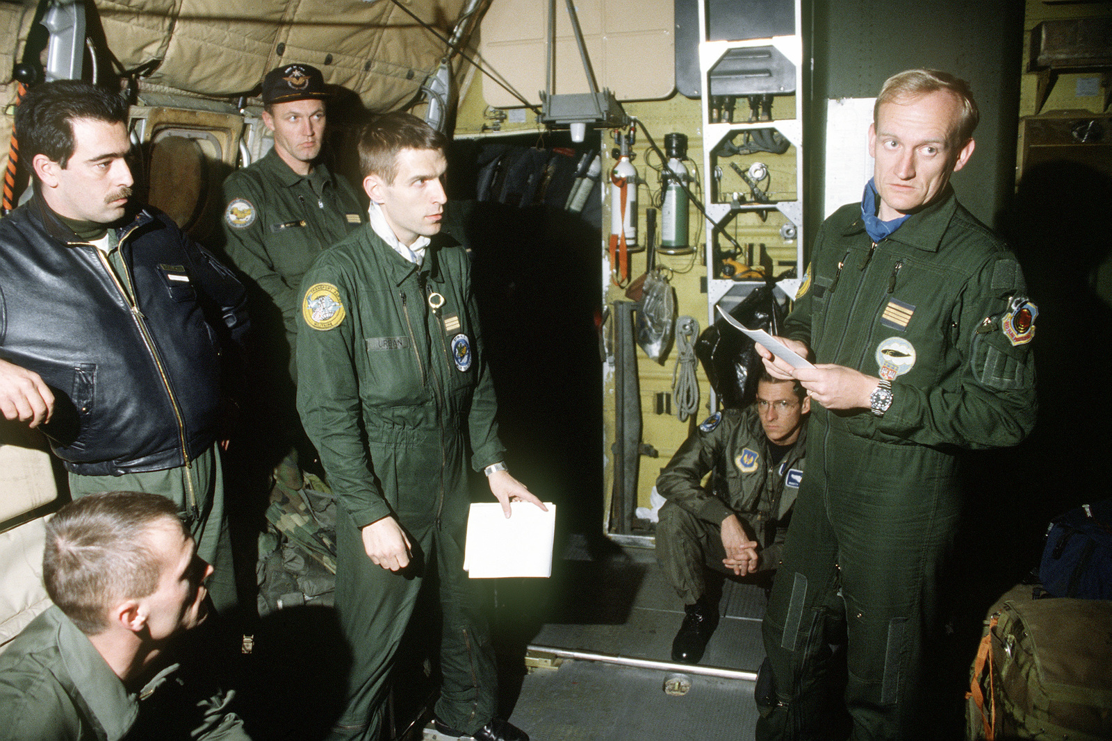 MAJ Maurin, a French Air Force C-160 Transall pilot, briefs his crew on their upcoming airdrop mission into Bosnia