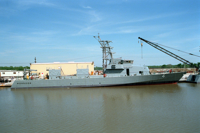 The patrol craft MONSOON (PC-4) stands moored to a pier while undergoing construction at the Bollinger Machine Shop and Shipyards