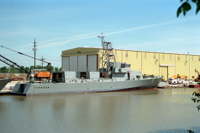 The patrol craft TYPHOON (PC-5) stands moored to a pier while undergoing construction at the Bollinger Machine Shop and Shipyards