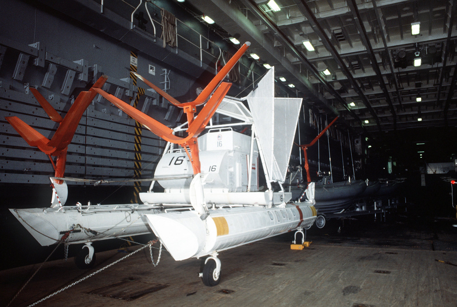 A view of a Helicopter Mine Countermeasures Squadron 15 (HM-15) Mark 105 hydrofoil minesweeping sled secured in the well deck of the amphibious transport dock USS DULUTH (LPD-6). The DULUTH is acting as a platform for HM-15 operations during the joint U.S. - Canadian fleet exercise MARCOT '93