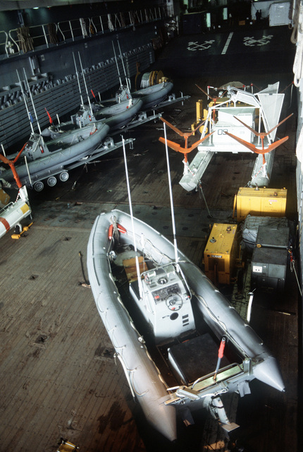 A view of a Mark 105 hydrofoil minesweeping sled and several rigid-hull inflatable boats of Helicopter Mine Countermeasures Squadron 15 (HM-15) secured in the well deck of the amphibious transport dock USS DULUTH (LPD-6). The DULUTH is acting as a platform for HM-15 operations during the joint U.S. - Canadian fleet exercise MARCOT '93