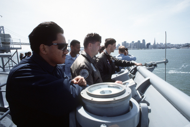 Crewmen watch from the deck as the amphibious transport dock USS DULUTH (LPD-6) prepares to pass under the Oakland Bay Bridge. The DULUTH is acting as a platform for Helicopter Mine Countermeasures Squadron 15 (HM-15) operations during MARCOT '93, a joint U.S. - Canadian fleet exercise