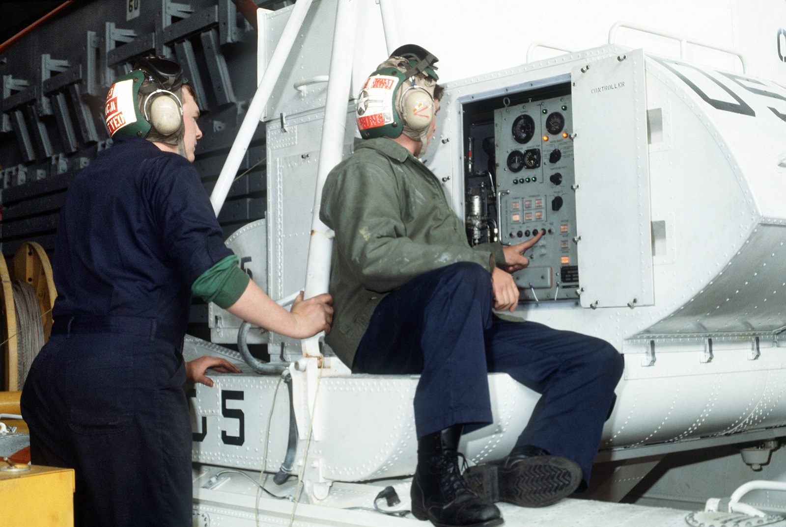 Members of Helicopter Mine Countermeasures Squadron 15 (HM-15) service a Mark 105 hydrofoil minesweeping sled in the well deck of the amphibious transport dock USS DULUTH (LPD-6). The DULUTH is acting as a platform for HM-15 operations during the joint U.S. - Canadian fleet exercise MARCOT '93