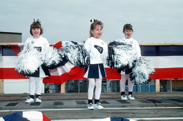 The JFK cheerleaders perform while waiting for their namesake, the aircraft carrier USS JOHN F. KENNEDY (CV-67) to return. This is the last time the KENNEDY will return to Norfolk before moving to its new home port at Mayport, Fla