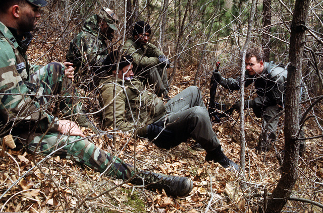CAPT. John Cottrell, a helicopter pilot from the 38th Air Rescue squadron instructs members of the 377th Medical Company in escape and evasion techniques during a joint Combat Search and Rescue training exercise