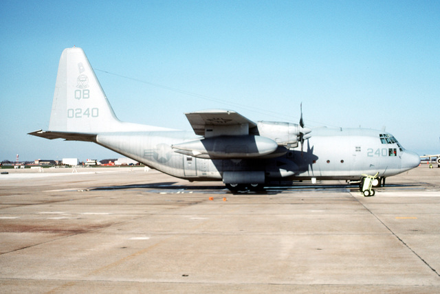 A right side view of a Marine Refueler Transport Squadron 352 (VMGR-352) EC-130R Hercules aircraft parked on the flight line