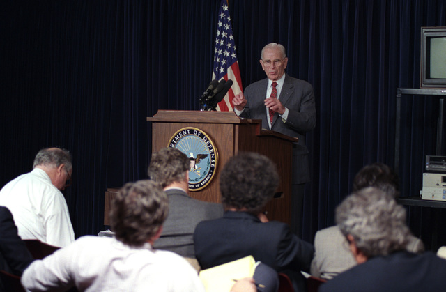 U.S. Army GEN. (Ret.) John W. Vessey, Jr. (at podium), attends a press briefing at the Pentagon, Washington, D.C., on April 21, 1993, about his recent trip to Hanoi, Viet Nam.  He discussed the issue of Prisoner's of War.  OSD Package No. A07D-00184 (DOD PHOTO by Helene C. Stikkel) (Released)