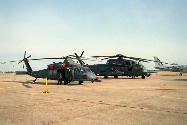 A right side view of an Air Force MH-60G pave Hawk helicopter and an MH-53J Pave Low III helicopter on display during air show