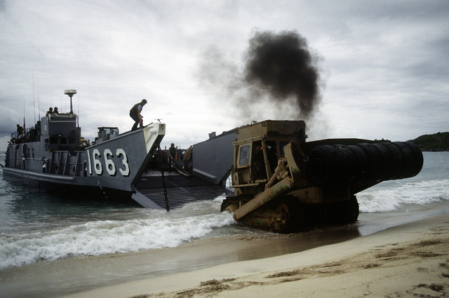 A bulldozer comes ashore from utility landing craft LCU-1663 during the joint service exercise Ocean Venture '93