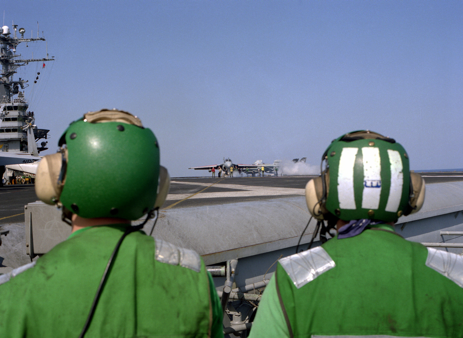 Flight deck crewmen watch from the deck edge as an A-6E Intruder aircraft is prepared for launch from the nuclear-powered aircraft carrier USS THEODORE ROOSEVELT (CVN-71) during Operation Deny Flight