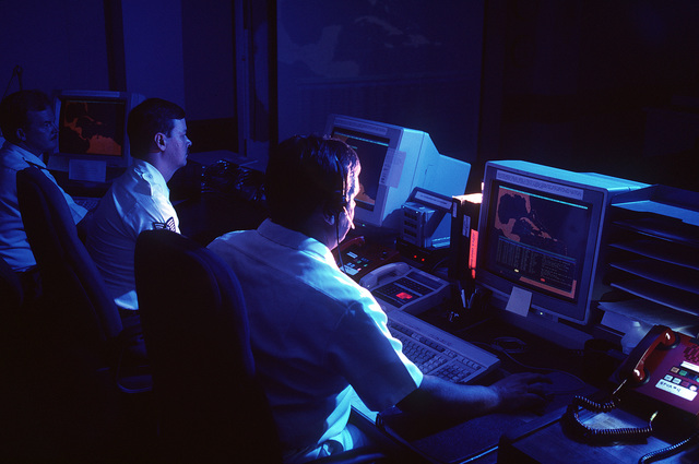 Intelligence and operations personnel from the Joint Task Force Four concentrate on their computer screens. The Joint Task Four controls sea, land and air resources providing law enforcement agencies with drug trafficking detection and monitoring capabilities in the Caribbean and eastern pacific