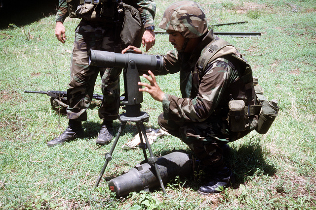 A member of Btry. R. 5th Bn., 10th Marine Regt., sets up an observation telescope at an artillery position during the joint service exercise Ocean Venture '93