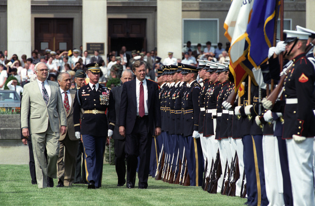 First row, left to right: the Honorable Secretary of Defense Les Aspin, Commander of Troops, the Honorable Bruce Babbitt, Secretary of the Interior.  Second Row, left to right: Individual unknown, the Honorable Marvin Runyon, Postmaster General, United States Postal Service.  Third row, General Colin Powell, Chairman, Joint CHIEF of STAFF, pass through an honor cordon during the 50th Anniversary celebration of the Pentagon in Washington, D.C., on May 12, 1993.  OSD Package No. A07D-00209 (DOD PHOTO by Robert D. Ward) (Released)