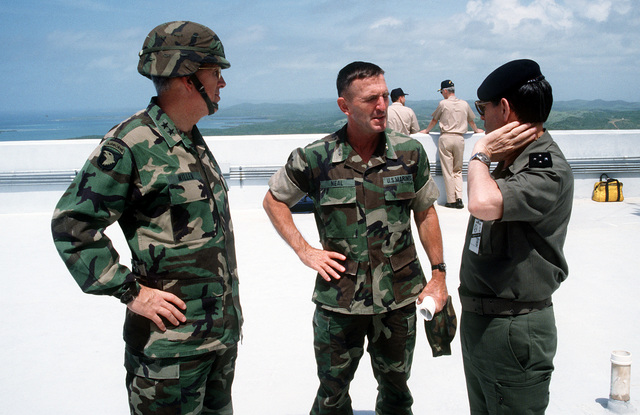 MAJ. GEN. Richard I. Neal, deputy commanding general, II Marine Expeditionary Force, and MAJ. GEN. John E. Miller, commanding general, 101st Airborne Division, talk with French GEN. Roquejeoffre during the joint service exercise Ocean Venture '93