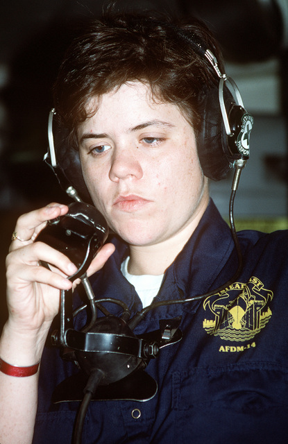 Fireman Kristin Bertrand uses a sound-powered phone aboard the medium auxiliary floating dry dock STEADFAST (AFDM-14) as utility landing craft LCU-1616 is undocked