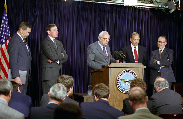"The Honorable Leslie""Les""Aspin (at podium), U.S. Secretary of Defense, addresses the media at a press conference on the formation of the Defense Science Board Readiness Task Force at the Pentagon, Washington, D.C., on May 19, 1993.  Also present are:  U.S. Marine Corps GEN. (Ret.) Joseph J. Went (left), former Assistant Commandant of the Marine Corps; U.S. Army GEN. (Ret.) Edward C. Meyer, former CHIEF of STAFF of the Army; U.S. Air Force GEN. (Ret.) Larry D. Welch, former CHIEF of STAFF of the Air Force; and U.S. Army GEN. (Ret.) Maxwell R. Thurman, former Commander, U.S. Southern Command.  OSD Package No. A07D-00223 (DOD PHOTO by Helene C. Stikkel) (Released)"
