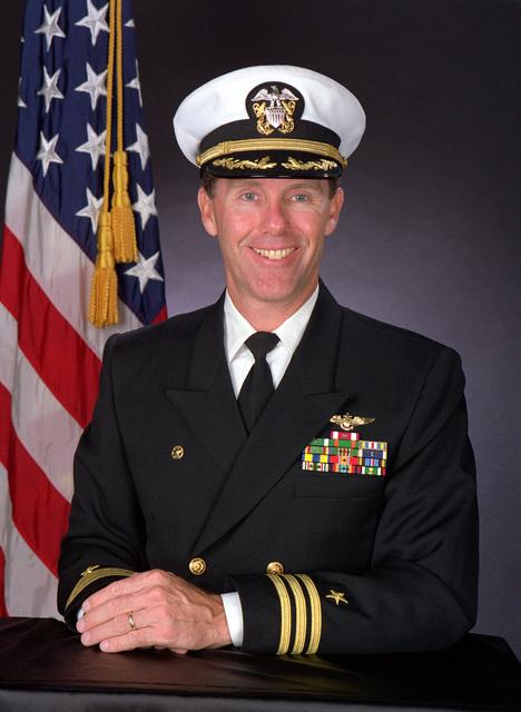CMDR. William J. Tyson, USN (covered)