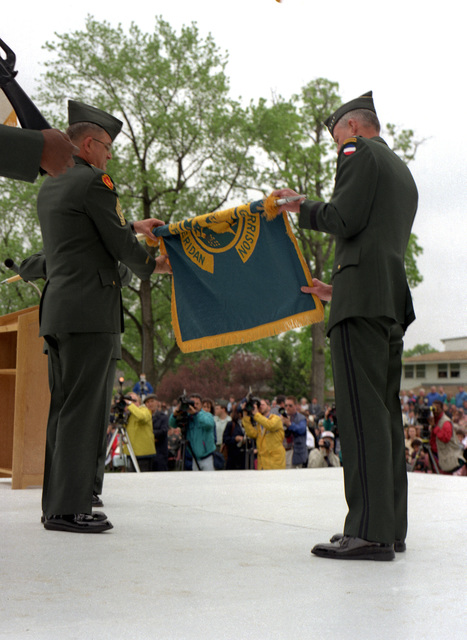 COL. Robert Frizzo and GEN. Dennis Reimer rolling up colors at deactivation ceremony of Ft. Sheridan