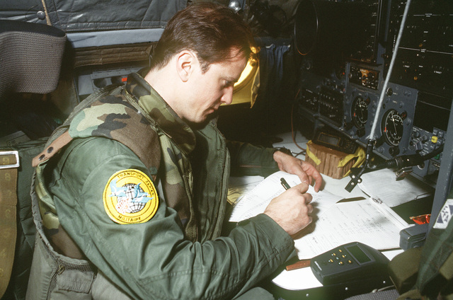 CPT Denis LeMeur, a French Air Force C-160 Transall navigator assigned to Anjou Tactical Squadron, 64th Wing, Eureux Air Base, France prepares for a TRIADS MRE drop into Srebernica, Bosnia