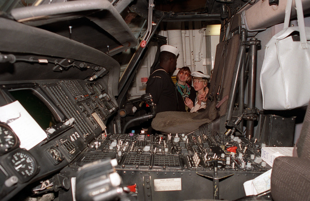 A sailor shows visitors the cockpit of a helicopter aboard the guided missile frigate USS DOYLE (FFG-39) during exercise BALTOPS '93. For the first time in the 22-year history of BALTOPS, the Eastern European countries of Estonia, Latvia, Lithuania, Poland and Russia were invited to participate in the non-military phases of the exercise. DEYO is serving as flagship for the exercise commander