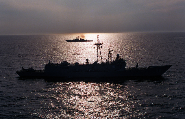 A starboard beam view of the guided missile frigate USS DOYLE (FFG-39) during exercise BALTOPS '93. The Russian Krivak I class frigate BDITELNY is in the background. For the first time in the 22-year history of BALTOPS, the Eastern European countries of Estonia, Latvia, Lithuania, Poland and Russia were invited to participate in the non-military phases of the exercise. DEYO is serving as flagship for the exercise commander
