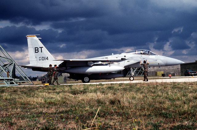 An F-15 Eagle from the 53rd Fighter Squadron, Bitburg Air Base, Germany, is met by maintenance personnel after a mission over Bosnia to enforce the No-Fly Zone