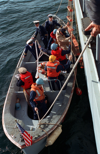 An officer from the destroyer USS DEYO (DD-989) climbs into a motor whaleboat for transport to the Russian navy Krivak I class frigate BDITELNY as part of an exchange of observers and crewmen during exercise BALTOPS '93. For the first time in the 22-year history of BALTOPS, the Eastern European countries of Estonia, Latvia, Lithuania, Poland and Russia were invited to participate in the non-military phases of the exercise. DEYO is serving as flagship for the exercise commander