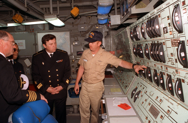 CAPT. W. Scott Slocum, Commander Destroyer Squadron 26 and commander of exercise BALTOPS '93, tours an engineering space aboard the destroyer USS DEYO (DD-989) with Russian Rear Adm. W.P. Comoyedoff, chief of the Baltic Squadron. DEYO is serving as Slocum's exercise flagship. For the first time in the 22-year history of BALTOPS, the Eastern European countries of Estonia, Latvia, Lithuania, Poland and Russia were invited to participate in the non-military phases of the exercise. DEYO is serving as flagship for the exercise commander
