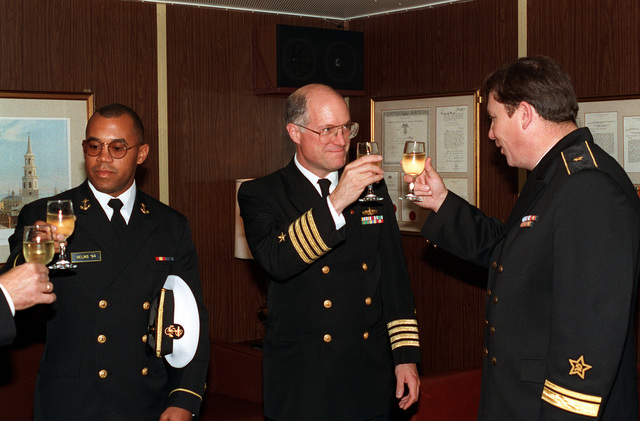 CAPT. W. Scott Slocum, Commander Destroyer Squadron 26 and exercise commander for BALTOPS '93, makes a toast with Russian Rear Adm. W. P. Comoyedoff, chief of the Baltic Squadron, during a reception aboard the destroyer USS DEYO (DD-989). For the first time in the 22-year history of BALTOPS, the Eastern European countries of Estonia, Latvia, Lithuania, Poland and Russia were invited to participate in the non-military phases of the exercise