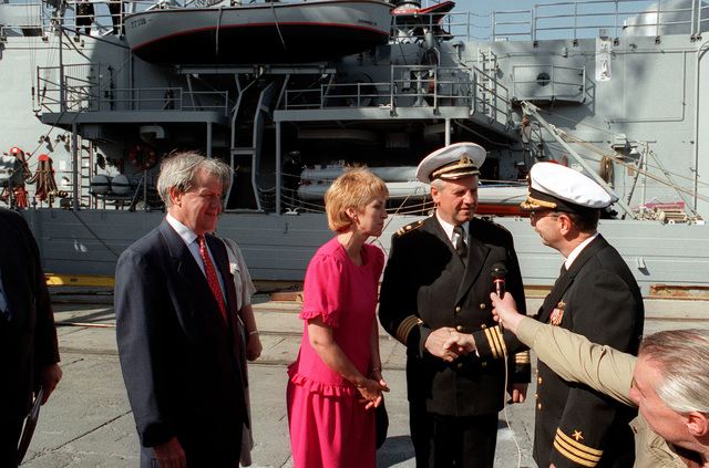 CMDR. George Schaeffer III, commanding officer of the guided missile frigate USS DOYLE (FFG-39), greets a Lithuanian naval officer pier prior to a reception aboard the DOYLE at the conclusion of exercise BALTOPS '93. U.S. Ambassador to Lithuania Darryl Johnson is at left. For the first time in the 22-year history of BALTOPS, the Eastern European countries of Estonia, Latvia, Lithuania, Poland and Russia were invited to participate in the non-military phases of the exercise