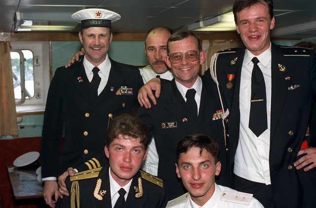 CMDR. Nathan Jones, a U.S. Navy public affairs officer, poses with Russian navy chief petty officers during a reception aboard the destroyer USS DEYO (DD-989). DEYO chiefs invited chiefs from other nations participating in Exercise BALTOPS '93 to attend the reception. For the first time in the 22-year history of BALTOPS, the Eastern European countries of Estonia, Latvia, Lithuania, Poland and Russia were invited to participate in the non-military phases of the exercise. DEYO is serving as flagship for the exercise commander