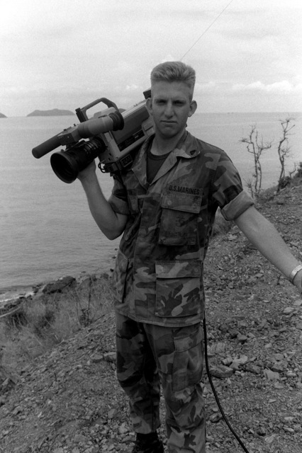CPL. Paul S. Royston, a Marine Corps Combat Cameraman, with camera on his shoulder, is photographed on location while deployed with MWSS-171 during Operation Cobra Gold 93