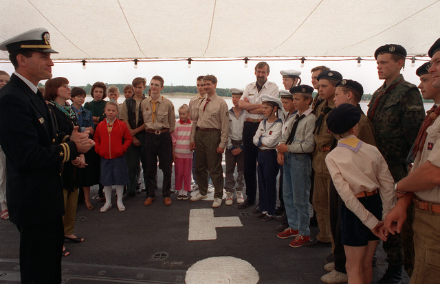 LT. Bill McQuilkin talks to a group of local Boy Scouts who are touring the guided missile frigate USS DOYLE (FFG-39) during exercise BALTOPS '93. For the first time in the 22-year history of BALTOPS, the Eastern European countries of Estonia, Latvia, Lithuania, Poland and Russia were invited to participate in the non-military phases of the exercise. DEYO is serving as flagship for the exercise commander