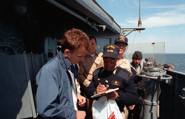 Midshipman 1ST Class Michael Nelms serves as an interpreter for U.S. sailors from the USS DEYO (DD-989) visiting the Russian navy Krivak I class frigate BDITELNY while taking part in an exchange of observers and crewmen during exercise BALTOPS '93. For the first time in the 22-year history of BALTOPS, the Eastern European countries of Estonia, Latvia, Lithuania, Poland and Russia were invited to participate in the non-military phases of the exercise. DEYO is serving as flagship for the exercise commander
